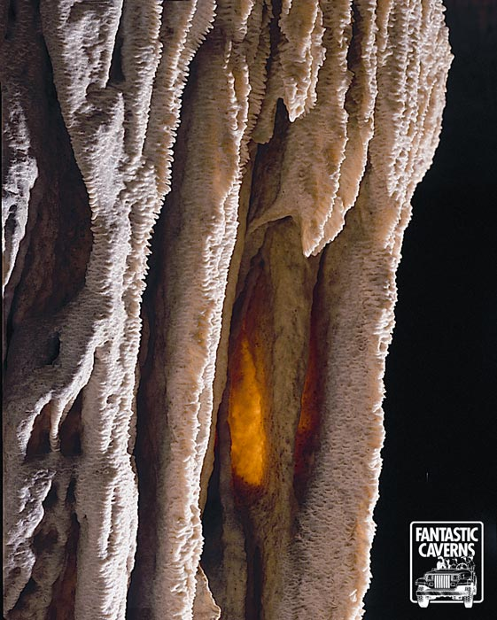 A Drapery formation inside Fantastic Caverns. It is among the most beautiful of our cave formations. A thin translucent formation made from calcite-rich solutions flowing along the underside of a sloping ceiling.